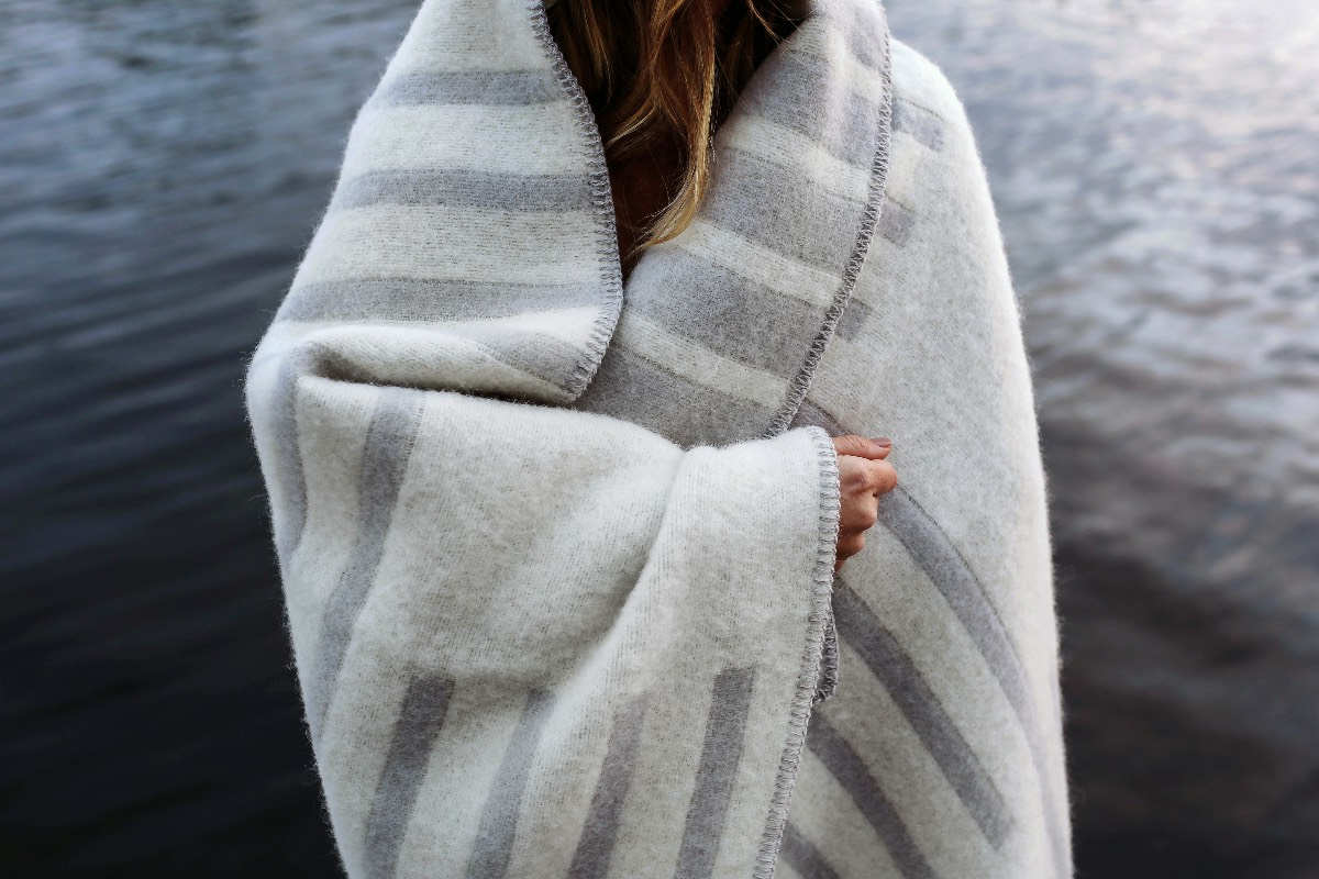 A woman wrapped in a Classic wool blanket.
