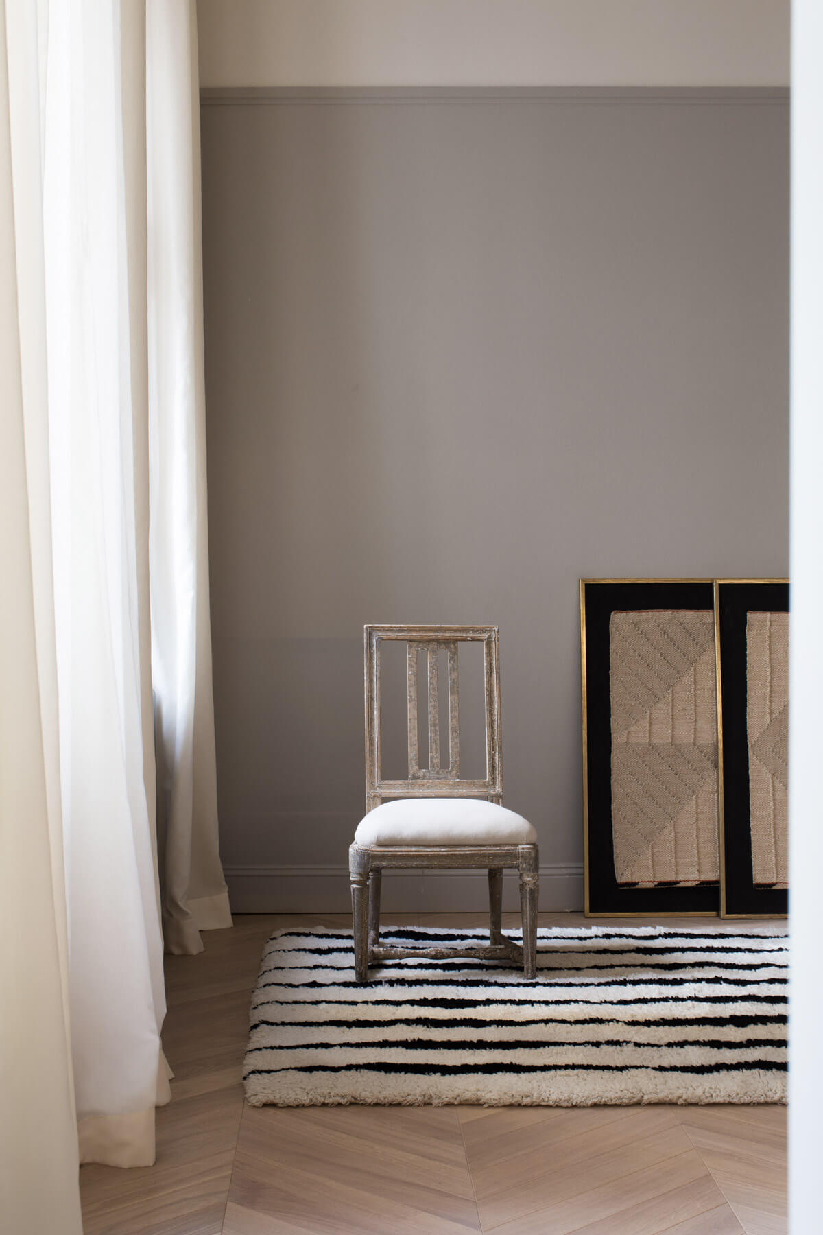 Fjord displayed in a beautiful apartment styled with an antique chair.