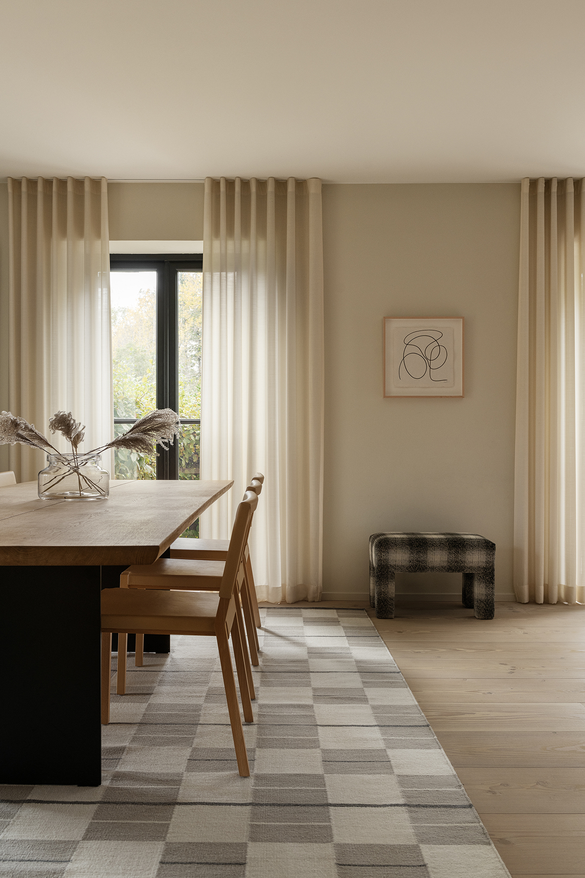 The Båstad rug in Cream displayed in a sunny dining room.