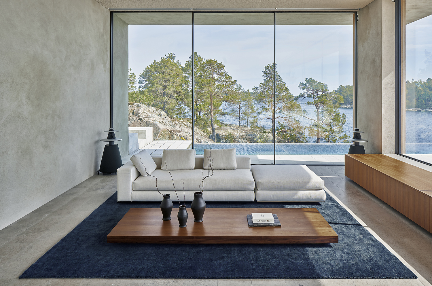 Plush rug Grand in color Deep Blue displayed in a contemporary archipelago house with a view.