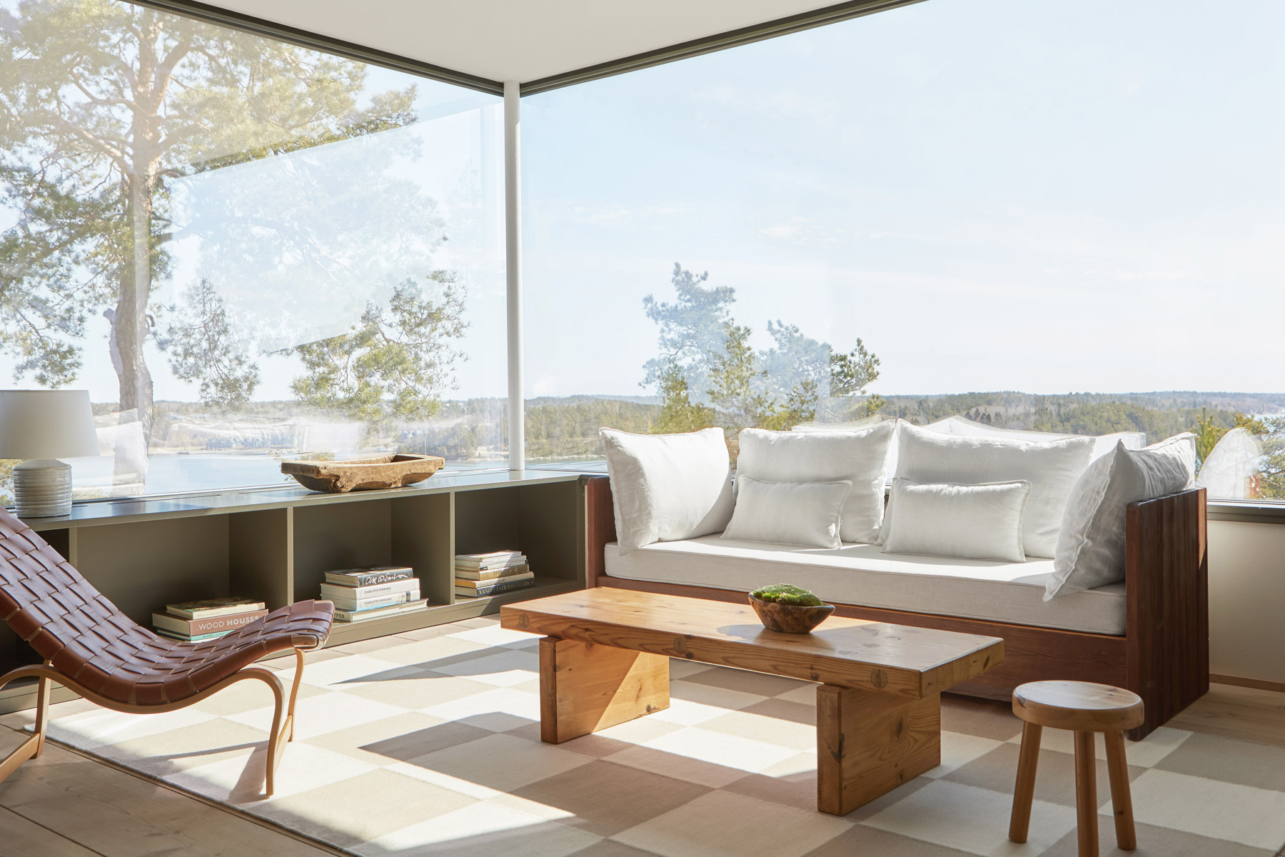 The Square flatweave rug photographed in a summerhouse in the Stockholm Archipelago.