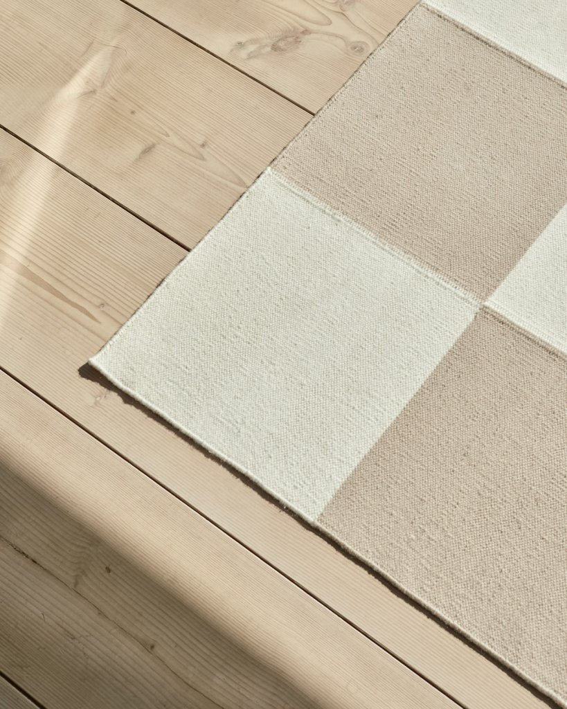Close up of the Square sand flatweave rug.