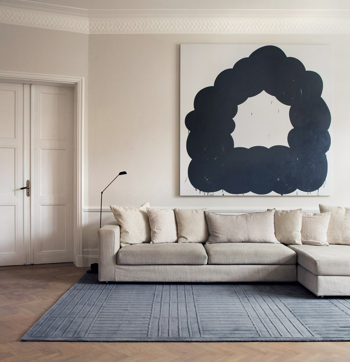 Plush rug Lx 1 in color Gray shown in a bright, beautiful living room.