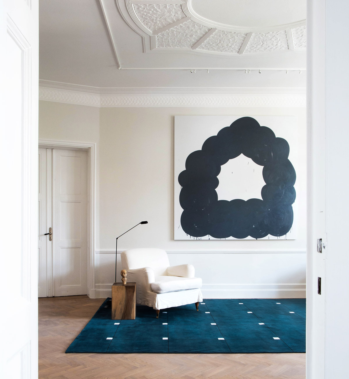 Plush rug Modern in Teal displayed in a bright, sunny living room decorated with a white armchair.