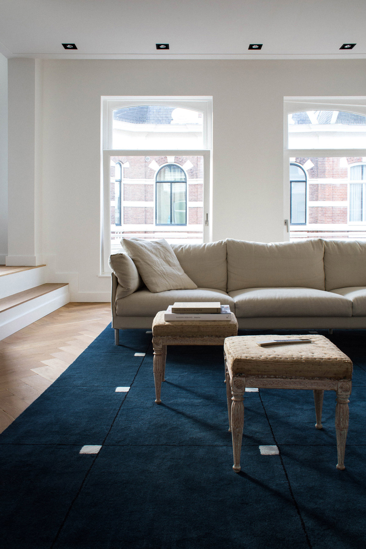Plush rug Modern in Teal displayed in a bright, sunny living room decorated with a beige couch.