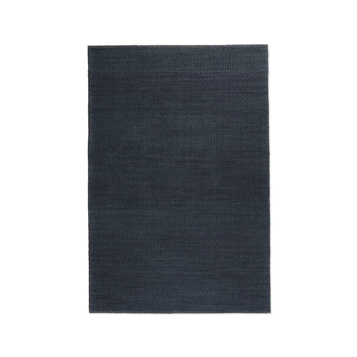Product image of the chunky flatweave rug Dunes in the color Night. It has a thick, braided texture.