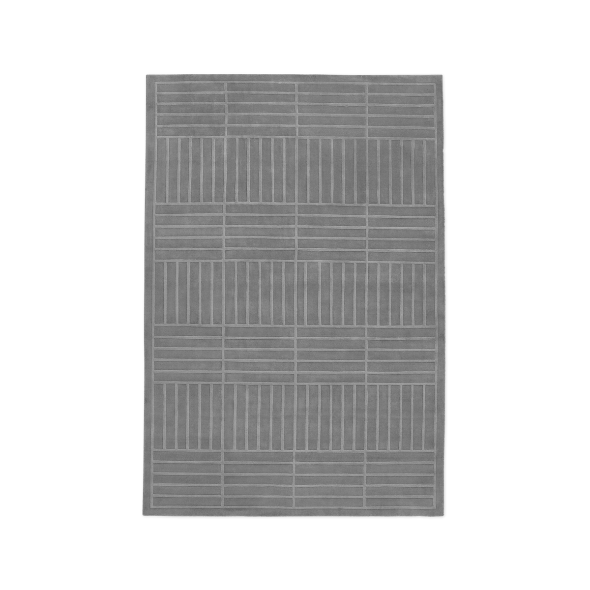 Product image of the plush rug Lux 1 in Gray. It has a cut-out graphic pattern spread across the rug.