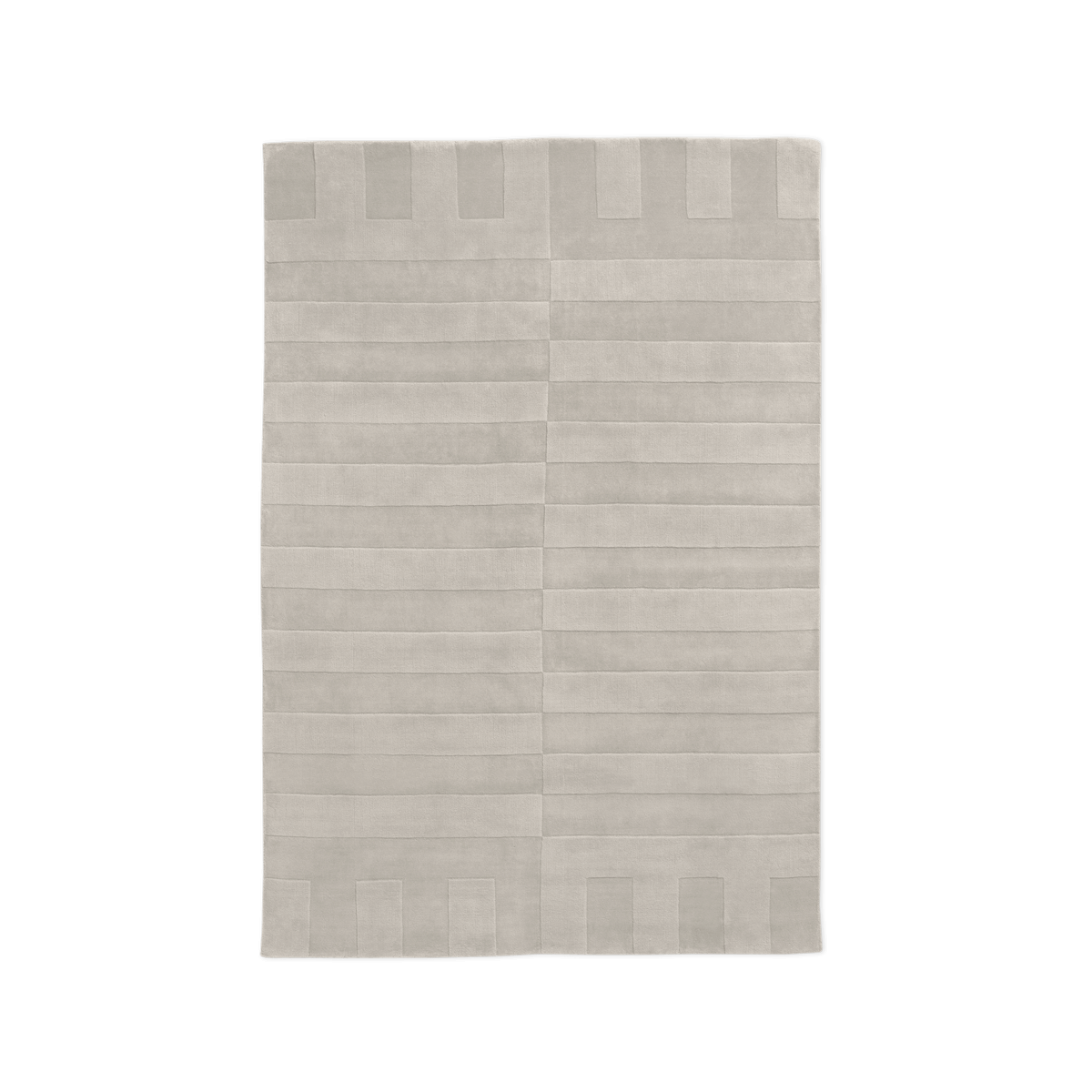Product image of the plush rug Lux 2 in the color Oatmeal. The pile of the rug is cut in different heights creating a blocky pattern across the rug.