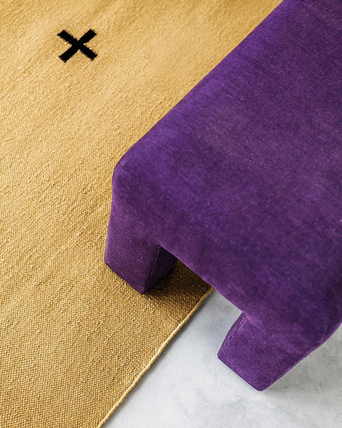 Close-up of Plus in the color Mustard.