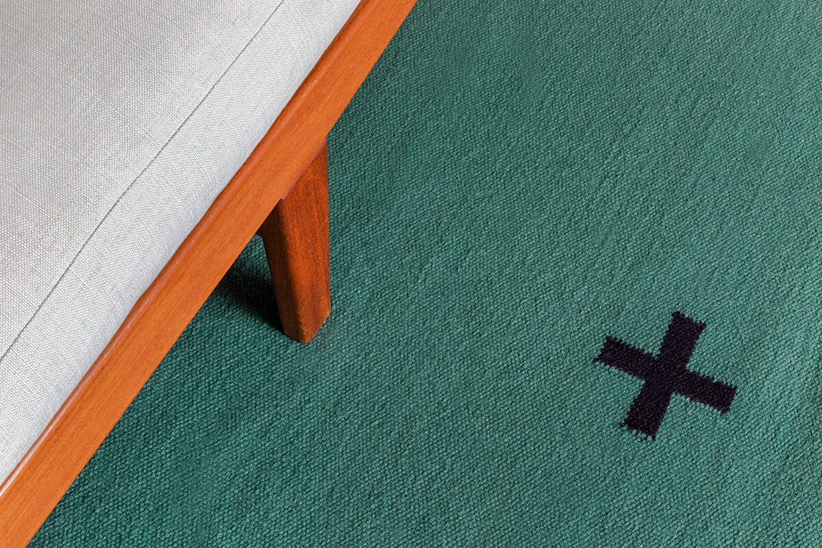 Close-up of a Green Plus rug.