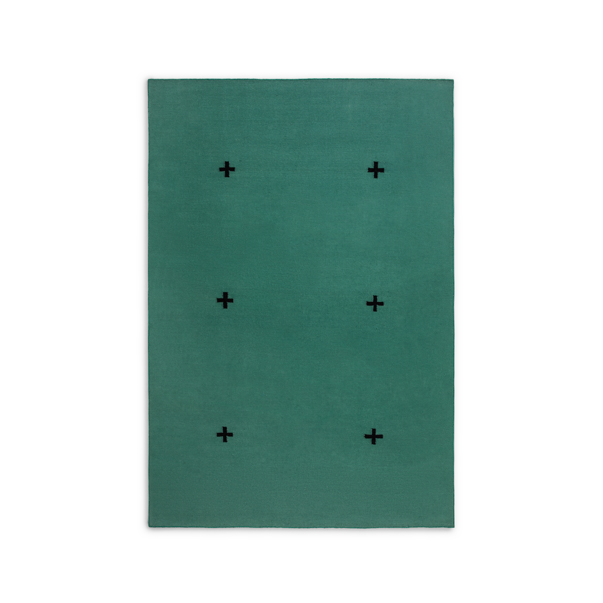 Product image of the flatweave rug Plus in the color Green. The rug itself is a green color with a graphic plus-sign pattern in a black shade.