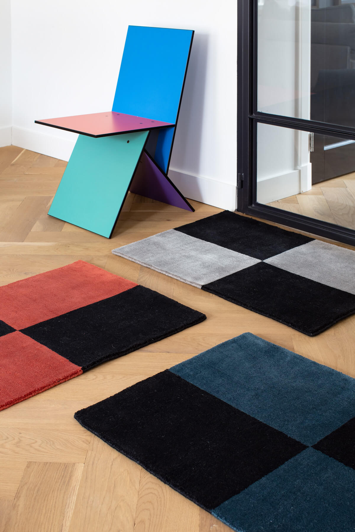 The door mat collection, displayed together with a colorful chair.