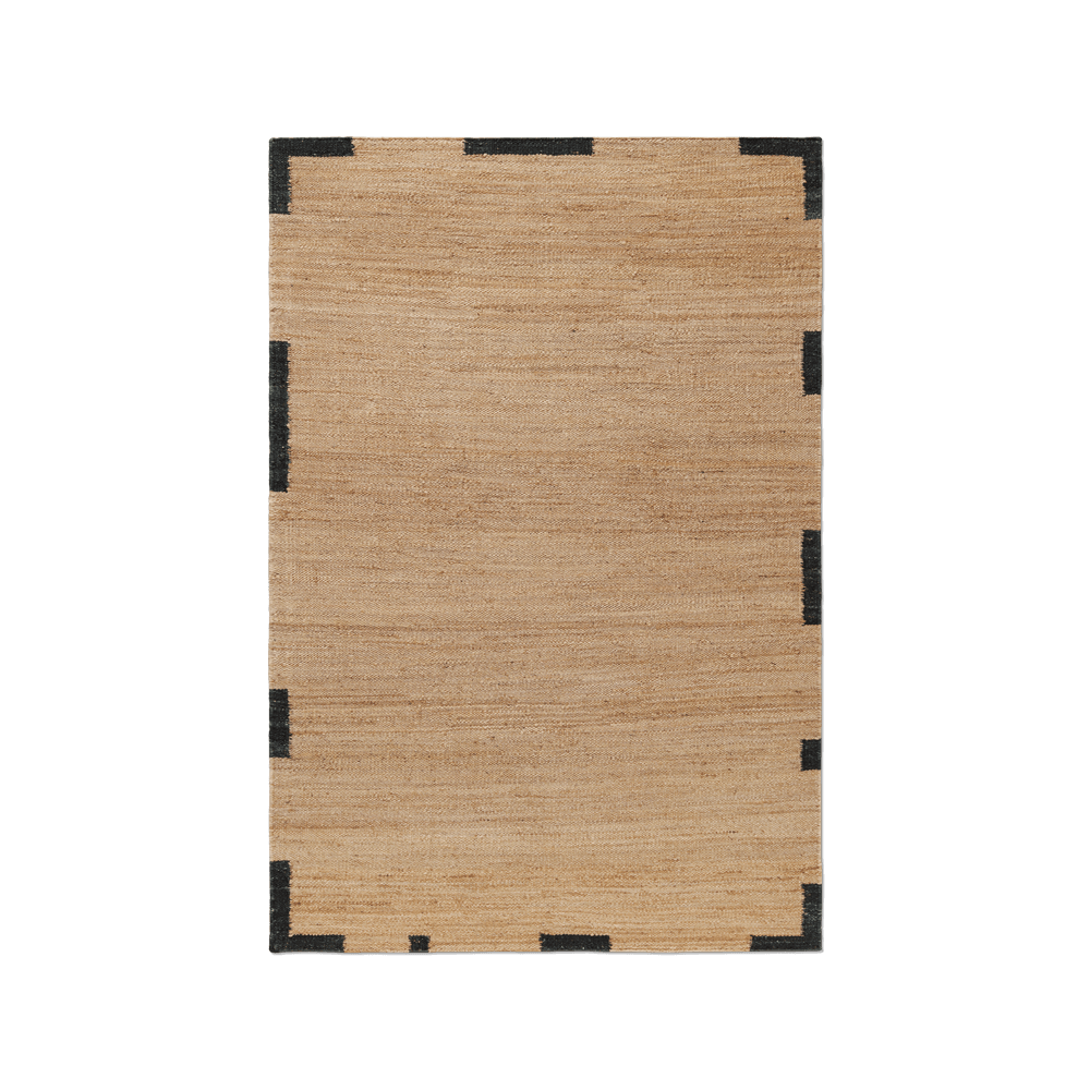 Product image of Jute Edge Black, a jute rug with an uneven frame around the edges.