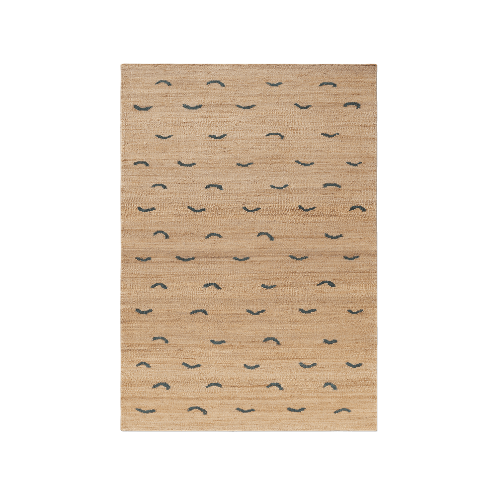 Product image of Jute Wave Teal, a jute rug with wave shapes spread across it.