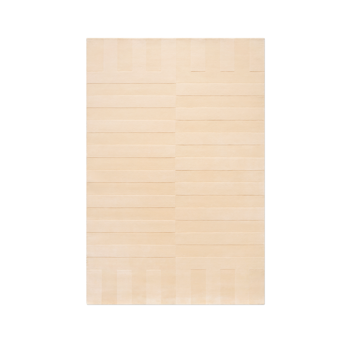 Product image of the plush rug Lux 2 in the color Dusty Apricot . The pile of the rug is cut in different heights creating a blocky pattern across the rug.