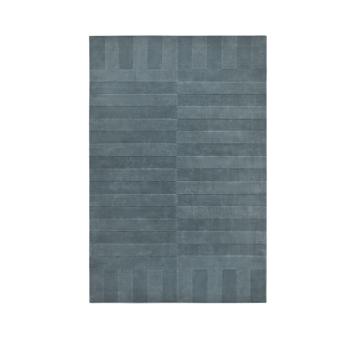 Product image of the plush rug Lux 2 in the color Petroleum . The pile of the rug is cut in different heights creating a blocky pattern across the rug.