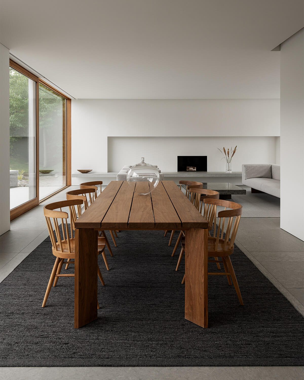 Zero in color Anthracite Mix shown in a contemporary house with a wooden dinner table and chairs.