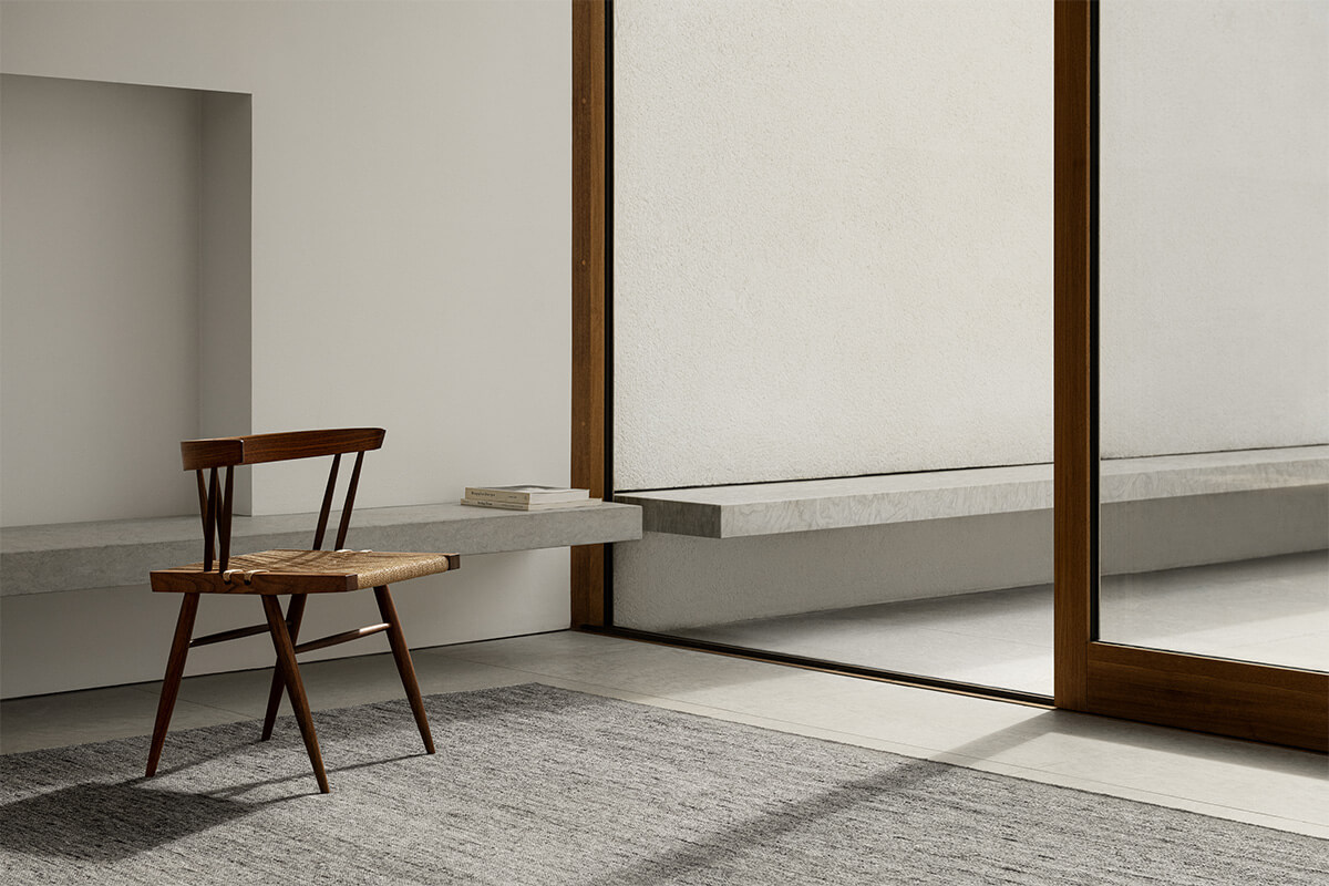 Zero in color Gray mix shown in a sunny, contemporary room styled with a wooden chair.