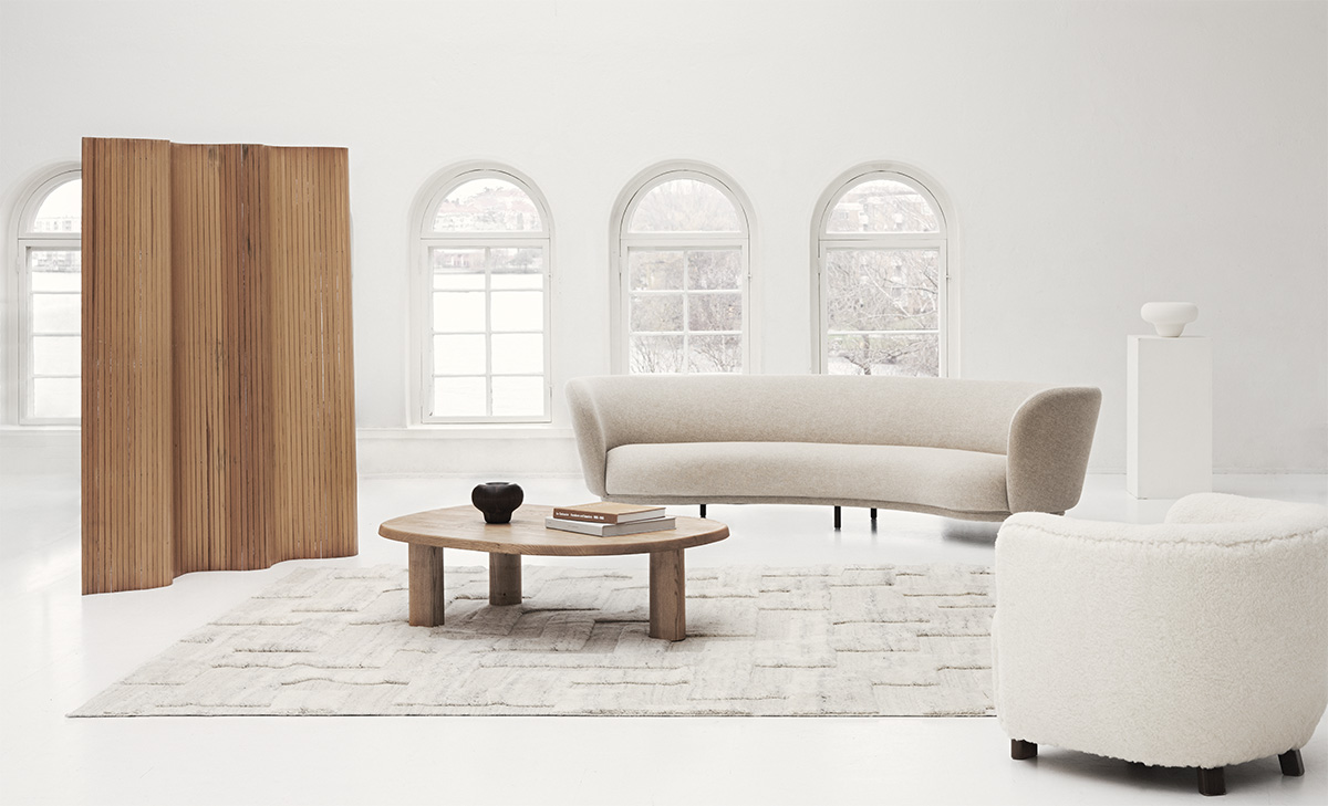 The Boho rug in Cream Mix displayed in a white, contemporary space with selected design pieces around it.