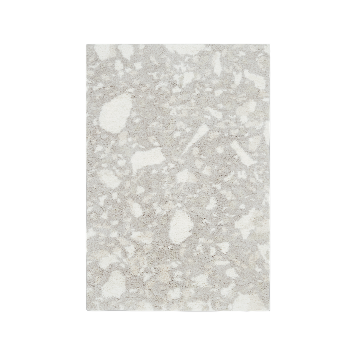 Product image of the shaggy rug Archipelago in the color Oatmeal. It has a natural, stone-like pattern across the whole rug.