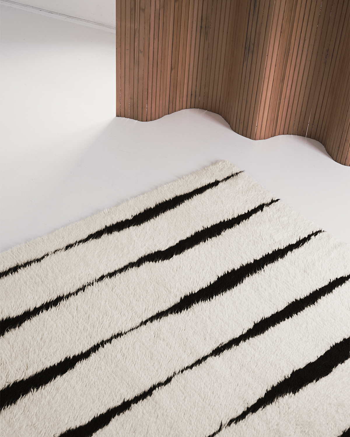 Close-up of the Fjord rug in color Cream and Black, showing the materials and texture.