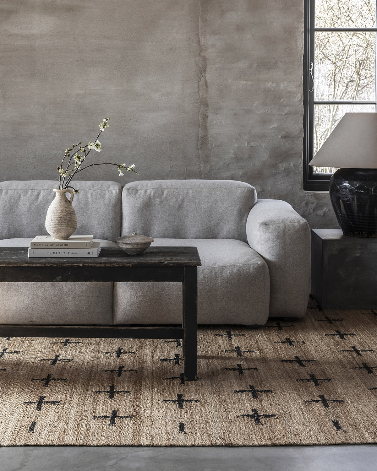The Jute Cross rug in Black in a beautiful contemporary living room.
