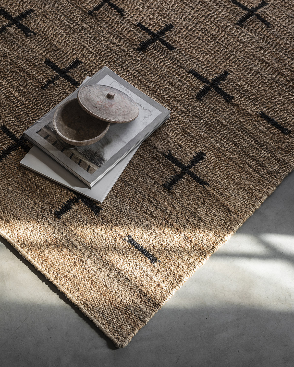 Close up of Jute Cross Black, showing of the texture of the jute material.