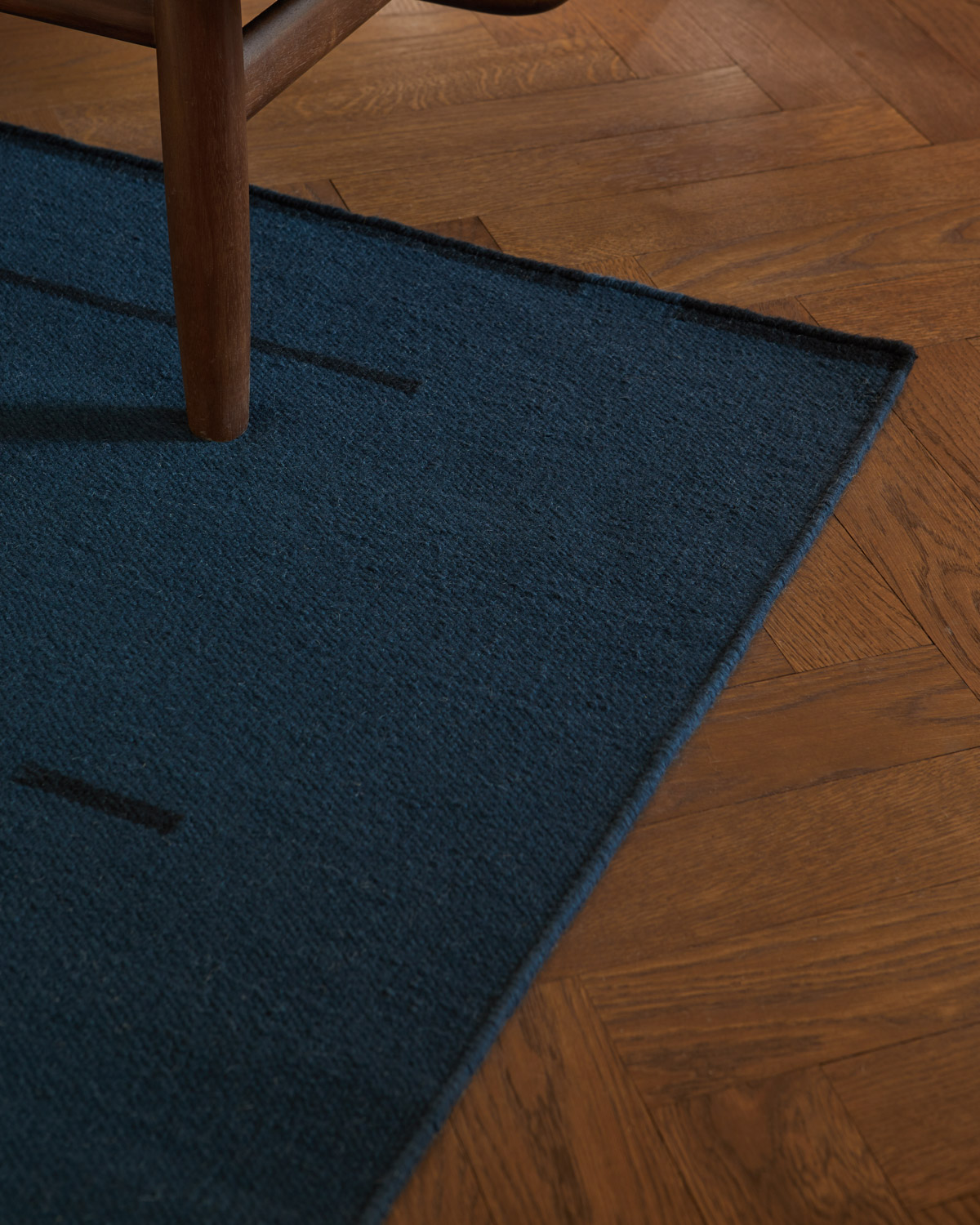 Close up of the Rain Teal flat-weave rug.