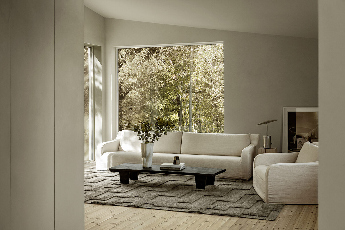 The Boho Gray Rug in a beautiful hose in the woods