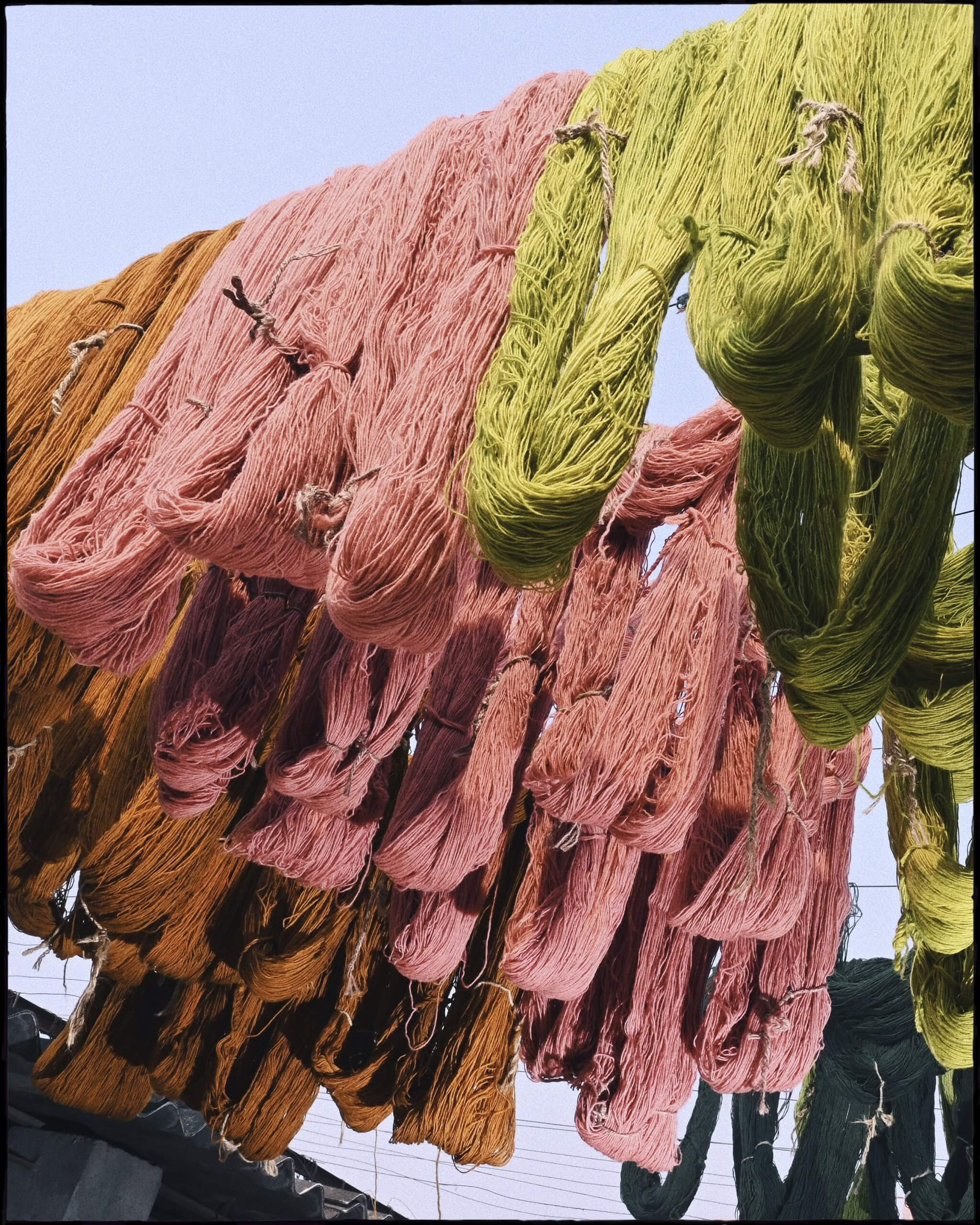 Dyed wool hanging to dry.