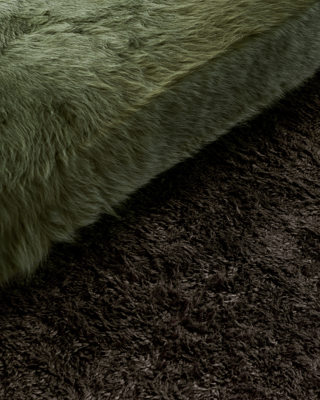 Close up of shaggy, dark gray rug Fields.