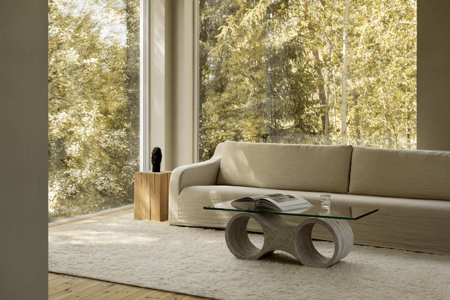 Fields in Dusty White in a beautiful room with large windows overlooking the woods.