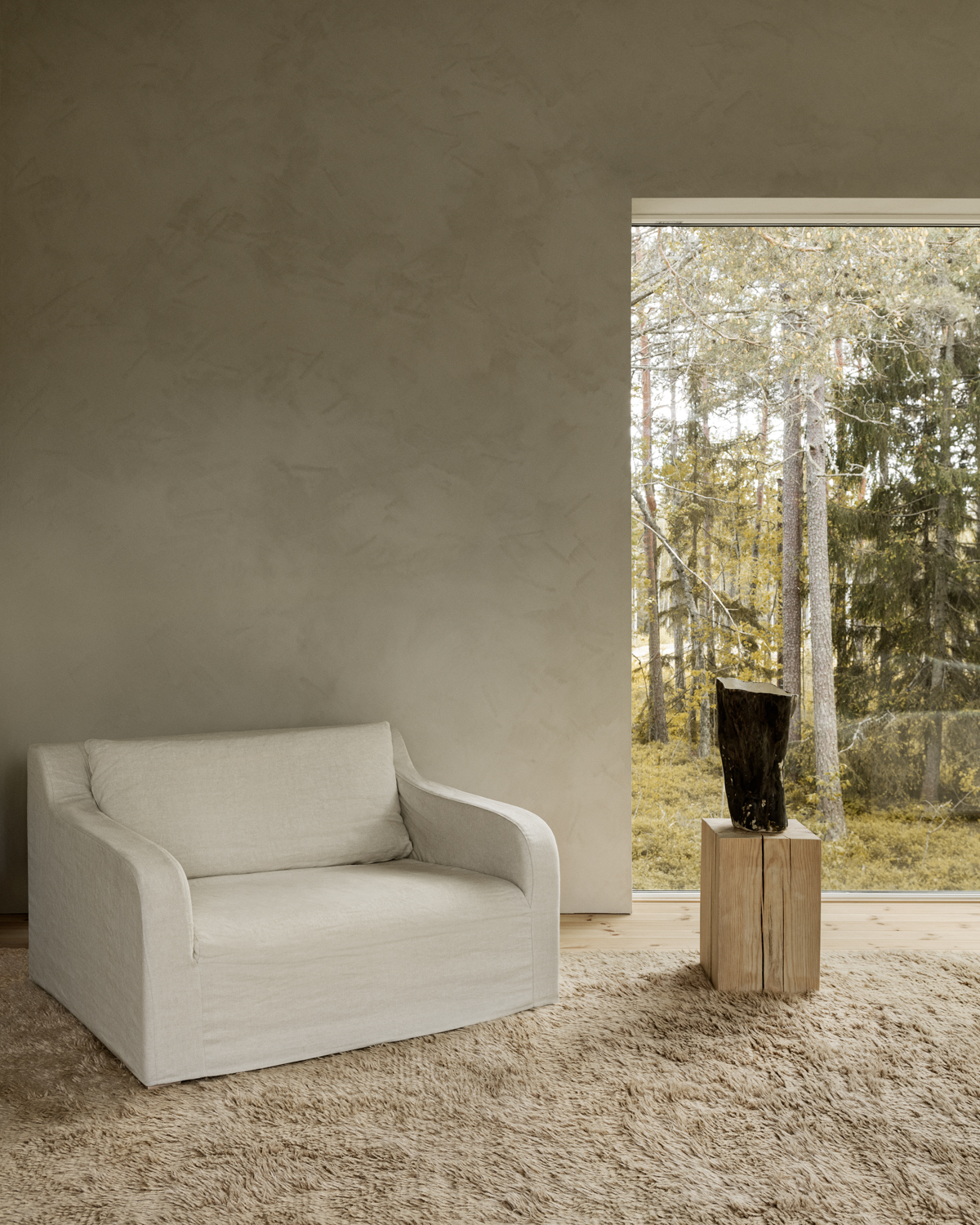 Fields in color sand displayed in a modern room with windows displaying the woods around the house.