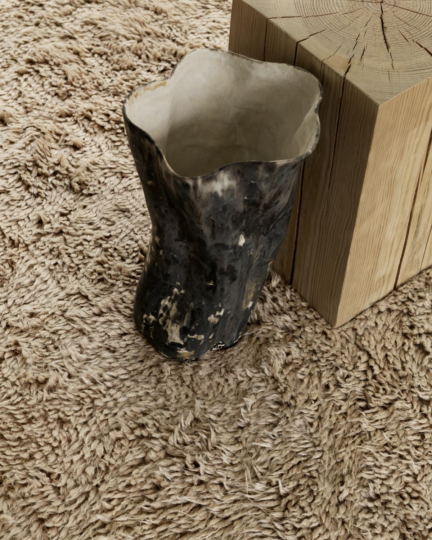 Close up of beige, shaggy wool rug Fields.