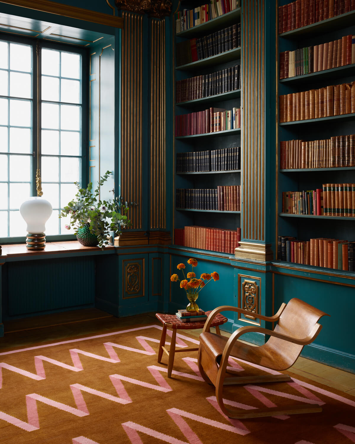 Folded Ribbon rug displayed in a gorgeous library.