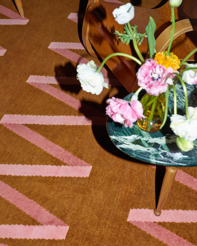 Close up of brunt orange and pink rug Folded Ribbon.