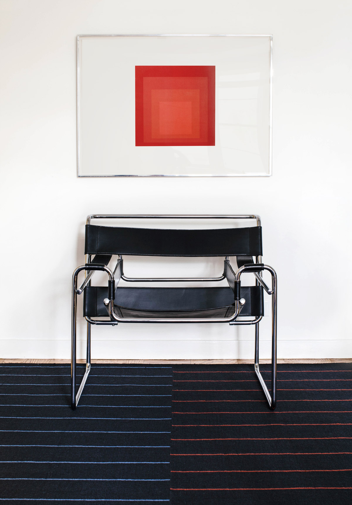 Barber in Black shown with a steel and leather armchair.