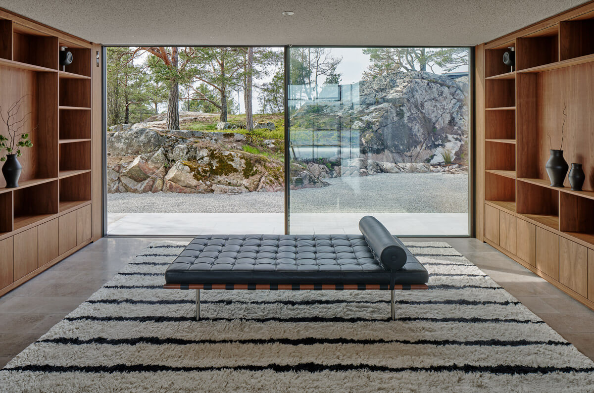 Shaggy rug Fjord in the color Cream and Black displayed in a contemporary, archipelago home with a leather day bed on top.