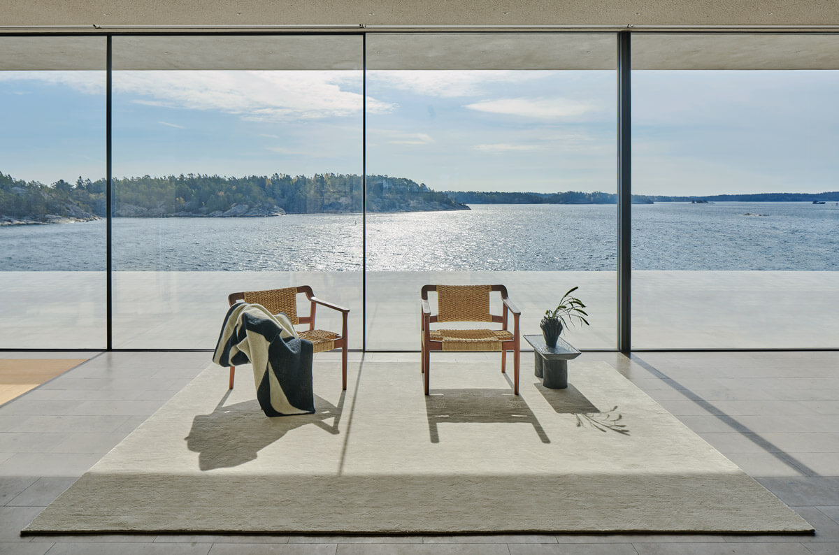 Grand on Dusty White displayed in a contemporary archipelago house with amazing view of the ocean.