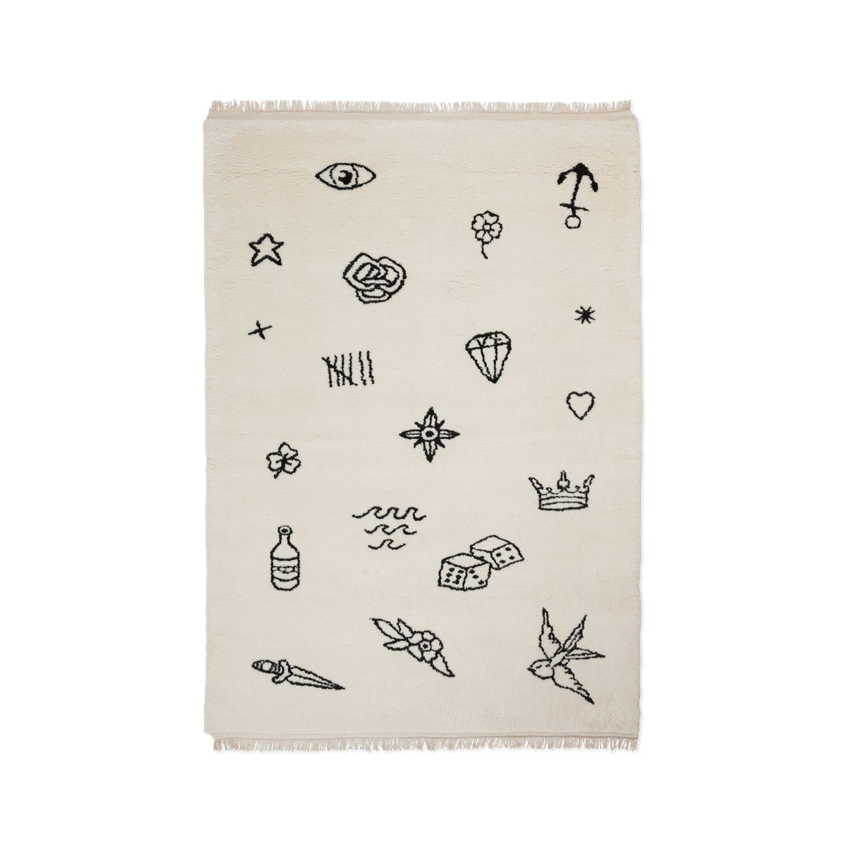 Product image of the shaggy rug Nomad in the color Cream. The rug has a irregular pattern of black classic sailor tattoos spread across it.