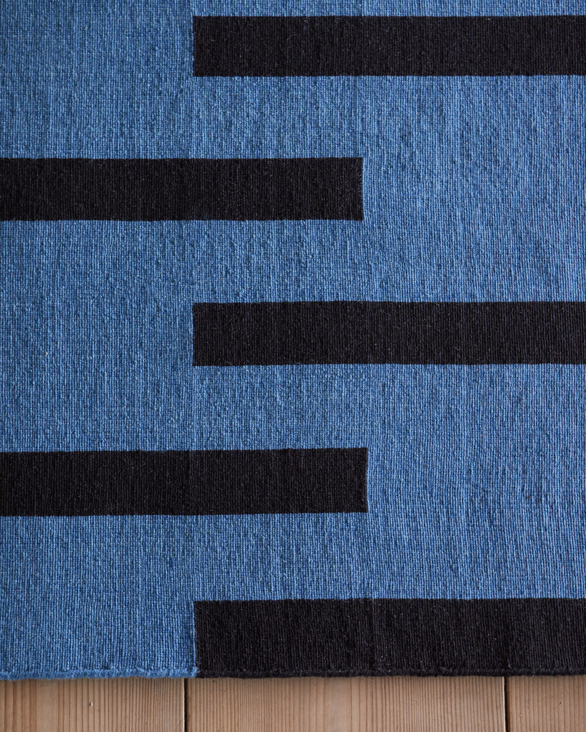Close up of Tiger rug in color combination Blue and Black.