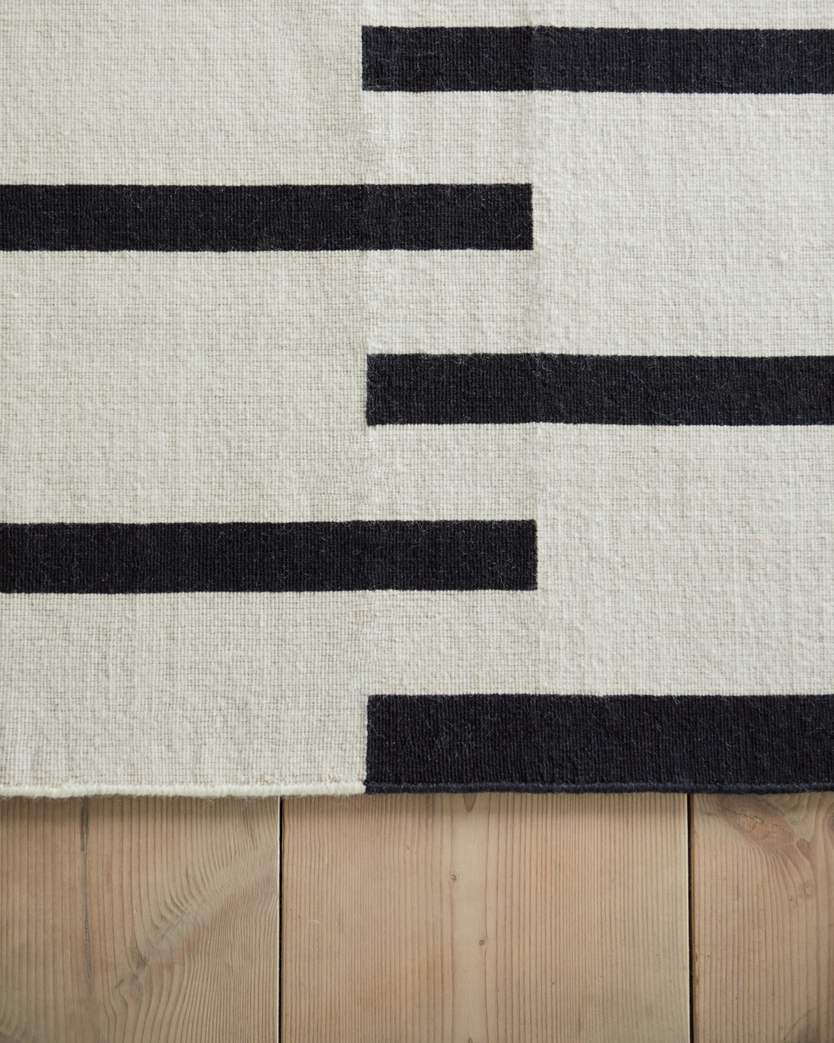 Close up of a Tiger rug in color combination Cream and Black.