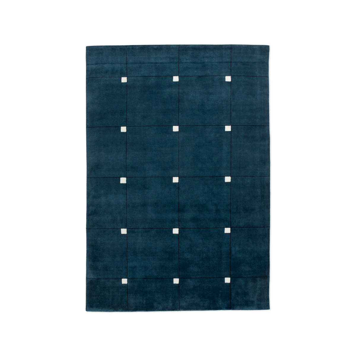 Product image of the plush rug Modern in the color Teal. The rug has a square pattern with small white squares in the upper right corners of the larger squares.