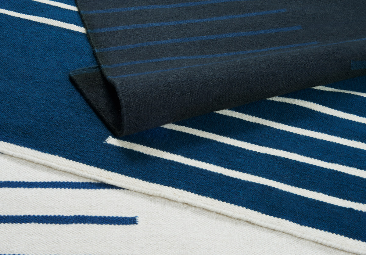 Close up of flatweave collection Classic in colors black, blue and cream.