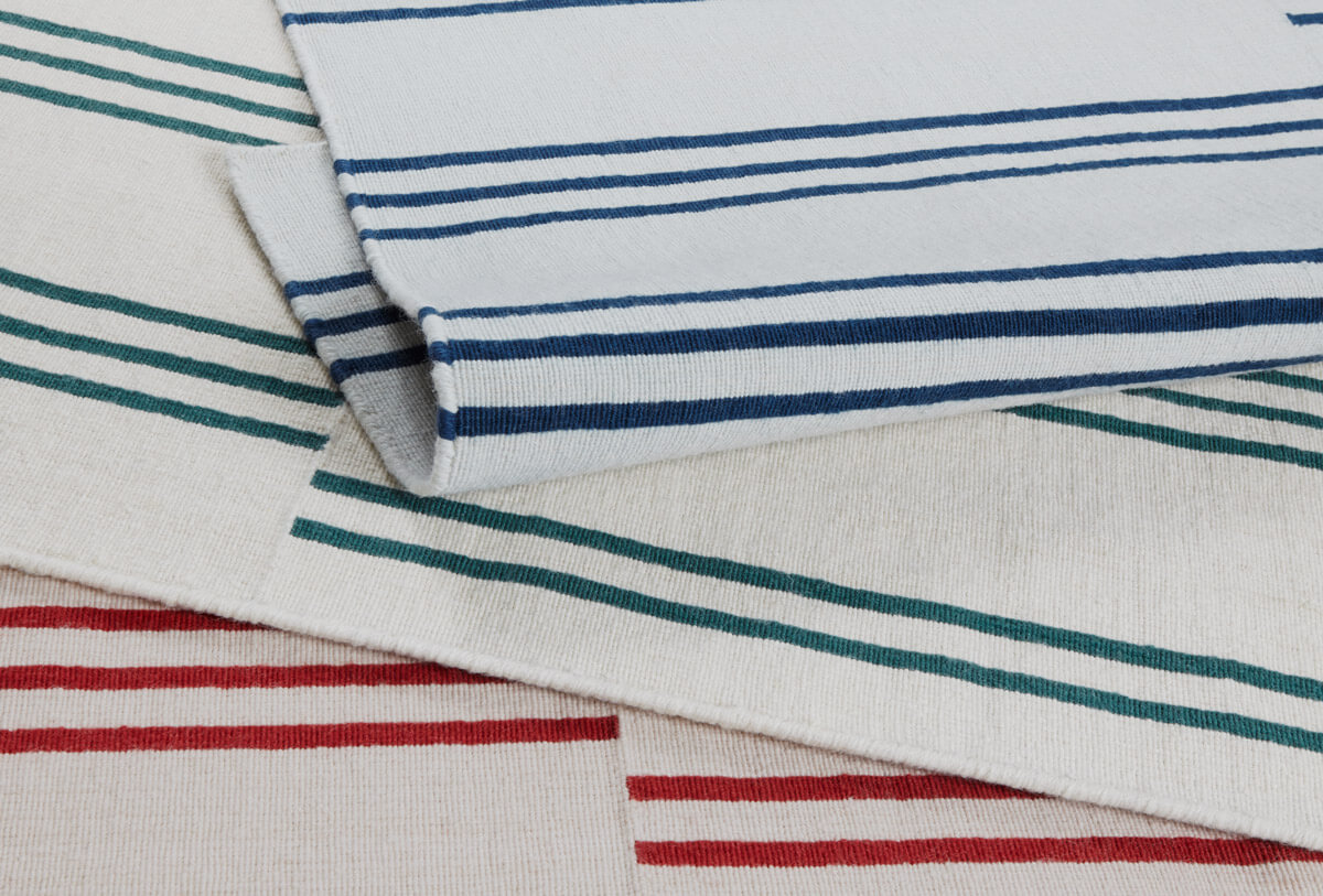 Close up of flatweave collection Stripes in blue, green and pink.