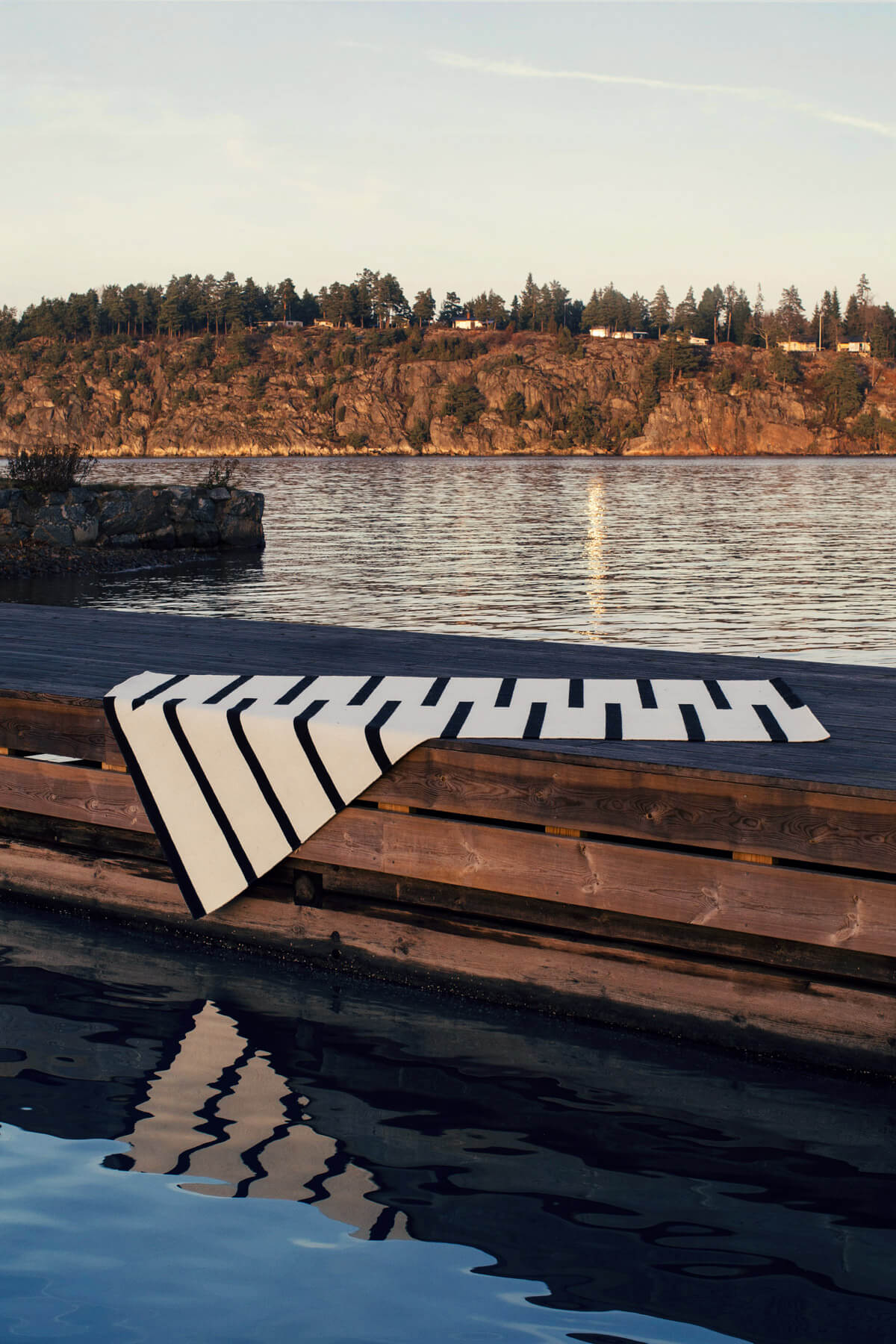 Tiger Cream and Black Rug on a pier in the Stockholm archipelago.