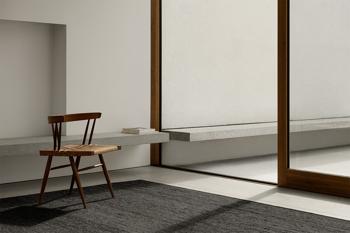 Zero in color Anthracite Mix shown in a sunny, contemporary room styled with a wooden chair.