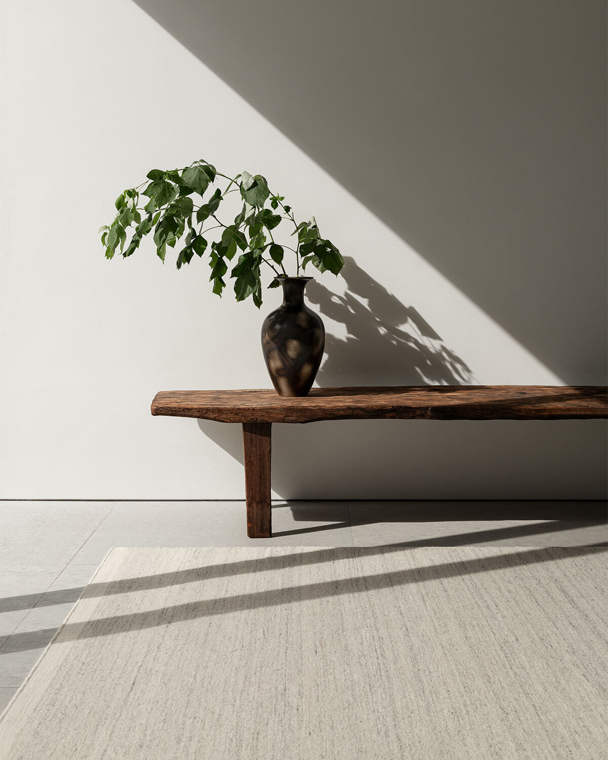 Zero in Cream Mix shown in a sunny setting with a wooden bench styled with a vintage vase.