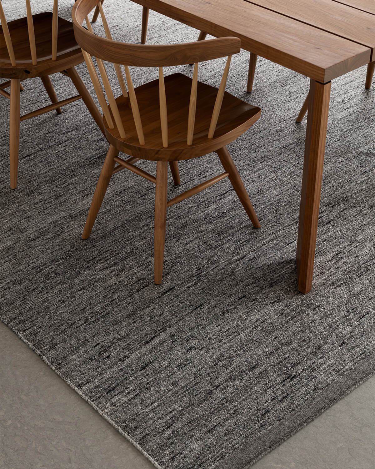 Close up of Zero in color Gray Mix, showing of the color and texture of the rug.