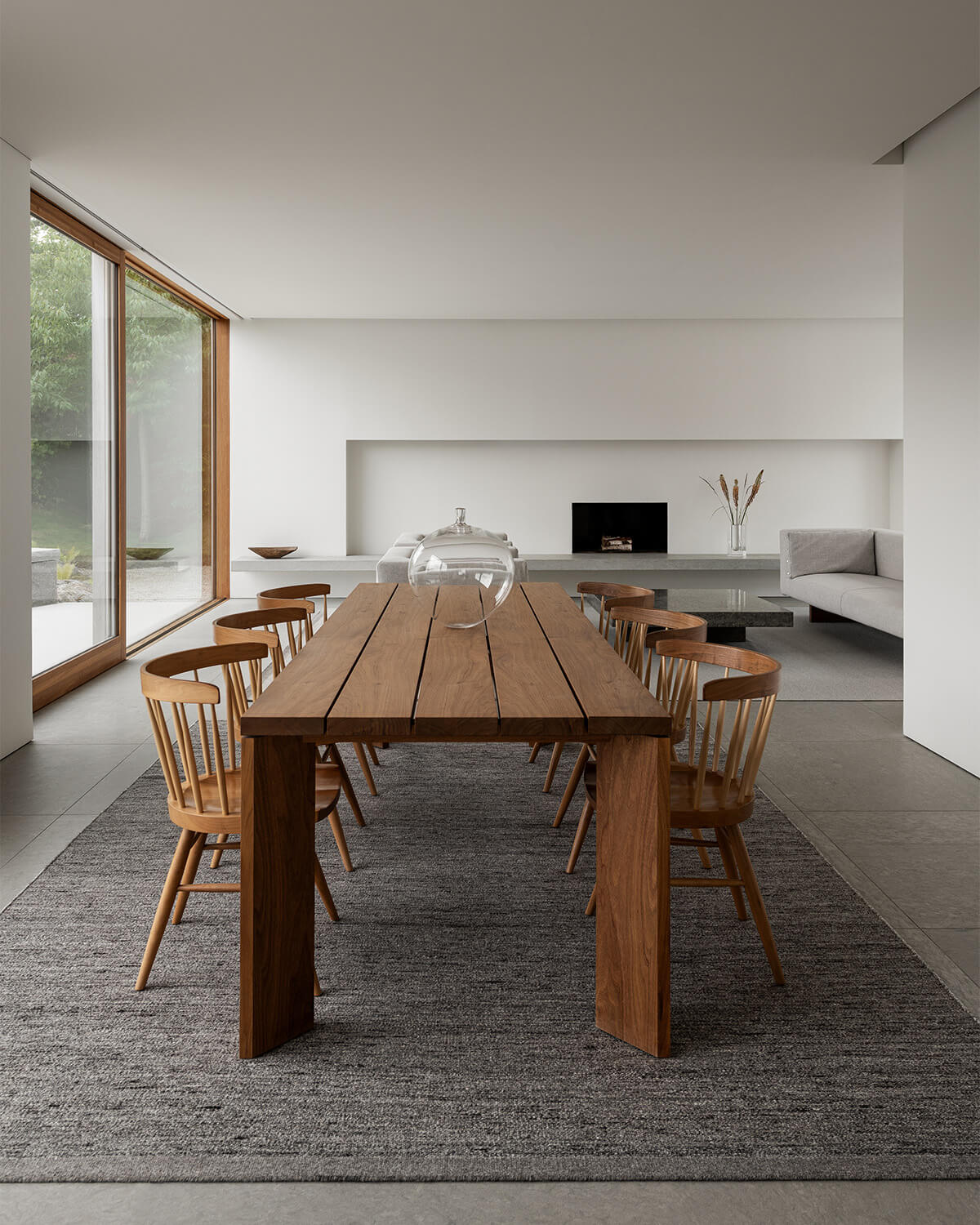 Zero in color Gray Mix shown in a contemporary house with a wooden dinner table and chairs.